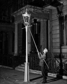 Lamplighter, Kensington, London, 1930