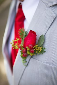 Red rose boutonniere for bridal party