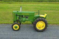 This is a 1948 Vintage John Deere Model M tractor