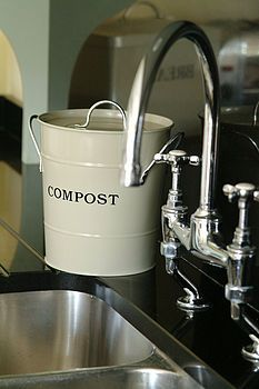 Need one of these instead of my ugly yogurt container. Snazzy compost collection container