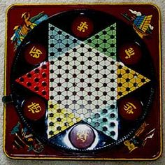 "Chinese Checkers...our set was like this one...a metal board with indentations for the marbles which were used as ""men"" for each player."