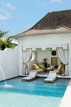 To us, this pool is perfect, with its fun fountain, wide steps, and teak chaises. The outdoor sitting area is the perfect place to enjoy the shade.