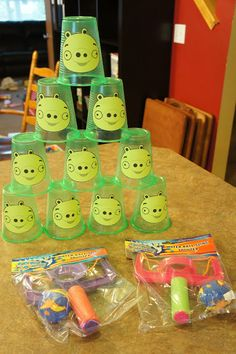 Day to Day: Angry bird party games Dollar Tree Sling Shots for the pool, and Dollar Tree green cups...easy, cheap, and fun!  Will do this for sure.