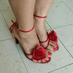 Pretty and Flirty  Red Roses High heels!! Slightly used. Pictures nos. 3 and 4 shows some minor wears on the shoes. Other than that, this pair of shoes is in great condition and very attractive!! Shoes Heels