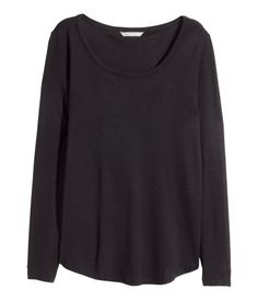Dark blue. Long-sleeved top in soft viscose jersey. Gently rounded hem.