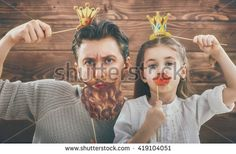 Funny family! Father and his child daughter girl with a paper accessories…