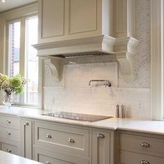 Light warm gray + white tile + accent mosaic tile