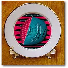 An electrical line on a blue pillow shape with pink layers behind Plate