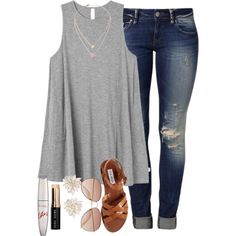 gray tee shirt, jeans, and brown shoes.