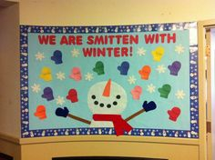 """Winter bulletin board. """"We are smitten with winter"""" and the mittens have the children's names on them."""