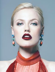 Deep rouge lips, fair skin, hair back and statement earrings. Standout shot by @MeaganCignoli