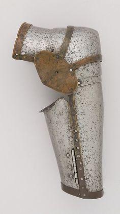 Left Arm Defense (Vambrace) Date: ca. 1380–1400 Culture: Italian Medium: Steel, brass Dimensions: H. 12 1/4 in. (31.1 cm); W. 4 3/4 in. (12.1 cm); D. 4 1/4 in. (10.8 cm); Wt. 1 lb. 9.5 oz. (722.9 g)