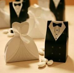 Cute idea for Wedding Reception. Bride and Groom Dress Favor Boxes. $7.88 Lot of 10 Bride Dress and 10 Groom Tuxedos (A total of 20 boxes) The bride can accommodate one Ferrero Rocher or 5 candy. The groom tuxedo can accommodate two Ferrero Rocher or 6 candy. http://www.amazon.com/Bride-Groom-Dress-Favor-Boxes/dp/B006ZS6172/?tag=sikot-20