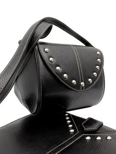 Leather bag with studs + iPad Case with studs.