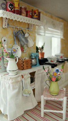 Kitchen. Love the tins on shelf.