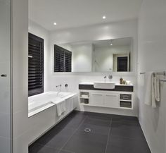 white vanity, grey tile bathroom