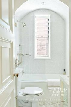 herringbone marble floors, shower arch, splash guard glass