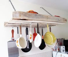 DIY Pot Rack Ideas: Pallets are so versatile. Here one is turned into a functional and interesting pot rack.