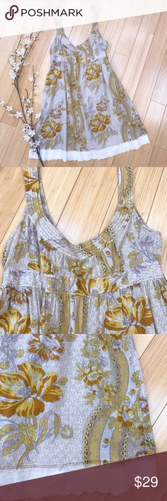 FREE PEOPLE linen sundress, 4. Cute BoHo shabby chic sundress by Free People, size 4. Beige with gold and cream lace trim, linen. One side of the tag has come loose. Side zipper, back tie. There's been one small repair on the strap, not noticeable unless you scrutinize. Matches with the feel of the dress. Bust is 18 inches, length is 35 inches. Free People Dresses