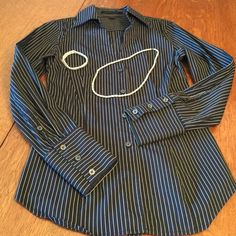 """Express blouse black striped button down Express blouse black striped button down has long sleeves with button cuffs. Great for work or accessorize for night ! bust 18"""" length 22"""" at sides and length 25"""" center Express Tops Blouses"""