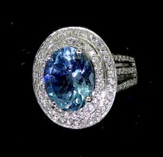 Can you believe the incredible talent of Peter Kumskov 'My Own Jeweller Direct' Brisbane? This Aquamarine and Diamond custom hand made White Gold Dress Ring would be the centre of attention in the poshest of world society http://jewellerdirect.com.au/image/data/Gallery/Dress%20Rings/Aquamarine-Centre-Gemstone-Encircled-Double-Row-Diamonds-Triple-Band-web.jpg