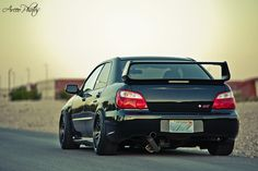 Straight pipe on Subaru Impreza WRX STi.
