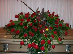 Fishing thru Eternity - all red rose casket spray with a fishing pole