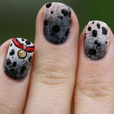 101 Dalmatians Nails! Its for my Disney NOTW Submission,  I watched the film last night. Its so cute!Ombre background for the soot on the dogs and obviously the spots because theyre dalmatians! and the collar is on the ring finger. My thumb came out the best but then the design was upside down so it was easier to do it like this :)