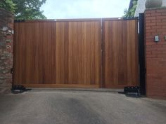 split gate with full electric automation. Constructed using hardwood iroko. Both larger gate and yard/ pedestrian gate able to open automatically. Side Gates, Front Gates, Entrance Gates, Driveway Landscaping, Backyard Fences, Garden Fencing, Timber Gates, Wooden Gates, Wooden Driveway Gates