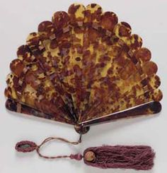 Brisé fan, 1905–10, Tortoiseshell blades, ring; silk, 30 cm (11 3/16 in.), The Elizabeth Day McCormick Collection, 43.1299.