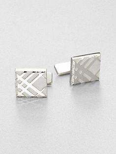 Elegant, embossed cuff links with signature Burberry check.