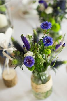 blue cornflowers & other blooms and greenery table bouquet
