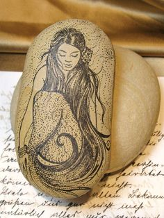 OMGosh! Mermaid on painted rock! I envisioned a rock painted very dark blue with stars and glitter in the background...:
