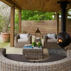 Outdoor Room with fireplace and wicker furniture
