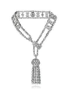 AN ART DECO DIAMOND BRACELET, BY VAN CLEEF & ARPELS   The central circular-cut diamond collets alternating with twin hexagonal-cut diamonds, within baguette and brilliant-cut diamond flexible tapered border, suspending a circular-cut diamond tassel, with sliding clasp, 1922, adjustable size, with French assay mark for platinum  Signed Van Cleef & Arpels Paris, no. 20711