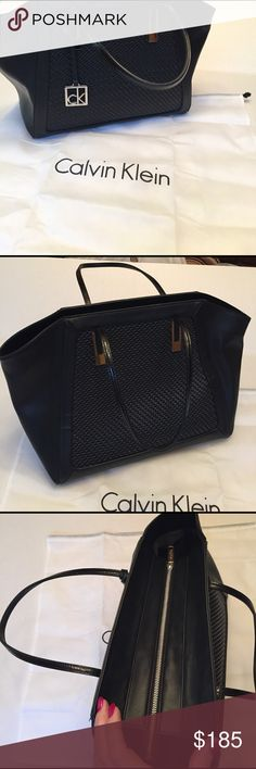 """Calvin Klein Handbag NWOT Gorgeous black soft and supple tote  purse by CK. Big enough to carry all you need if you're like me and need to carry a big purse. Measures 15 inches wide 12 inches tall and 7 inches deep with a 10"""" drop. NWOT includes dust bag. Ready for your wardrobe. Calvin Klein Bags Totes"""