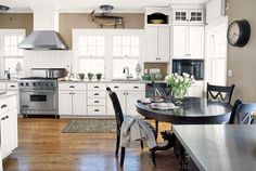 grey houses with white trim | Kitchen - taupe paint with white cabinets and trim and black furniture ...