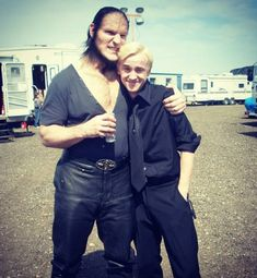 my draco malfoy just looks so good even looking good when standing beside an ugly guy