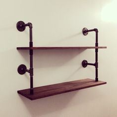 These wall mounted shelves are 36 wide, 9 deep, and about 22 tall. They are made of clear coated black steel pipes and stained pine wood (shown