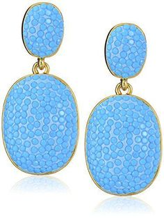 Add a pop of color with these beautiful blue statement earrings.