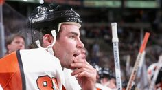 Eric Lindros, deep in thought, on the Philadelphia bench.