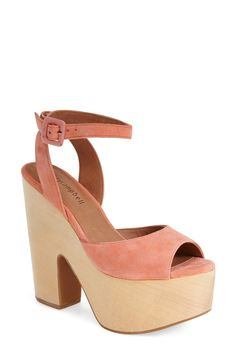 Pairing these wooden platform sandals with a flowy white dress for a groovy, 70's-inspired feel.