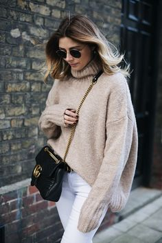 Emma Hill wears beige chunky knit, white skinny jeans, Black leather Gucci Marmont bag medium, gold frame round Rayban sunglasses, chic winter outfit