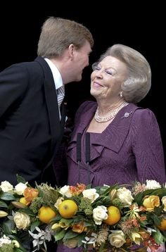 Dutch King Willem-Alexander (L) kisses his mother Princess Beatrix of Netherlands at the balcony of the Royal Palace in Amsterdam April 30, 2013. The Netherlands is celebrating Queens Day on Tuesday