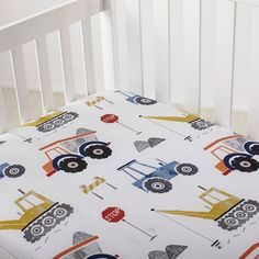 Construction-themed kids' sheets & bedding set with dump trucks, cranes, and bulldozer. These imaginative sheets for kids are woven of smooth cotton percale.