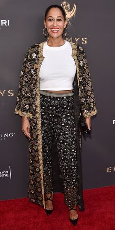 Tracee Ellis Ross caught onto the maximalist trend for the Television Academy's Performers Peer Group Celebration, wearing an opulently embroidered duster coat with high trousers and a simple white tee. A pair of strappy pumps, gold hoop earrings, and a little black clutch finished the look.