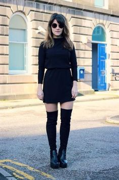 Fall/winter outfit - sleek all black look. Turtleneck tucked into a mini skirt with knee high socks and chunky ankle boots.