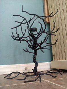 This is a metal tree that can be used as a necklace or jewelry holder. It has one candle in the top center. These can be made however you would like and each one would be absolutely unique. They could also be painted in a range of colors and made in a range of sizes. Only $70
