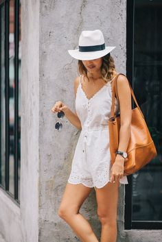 white romper and leather tote