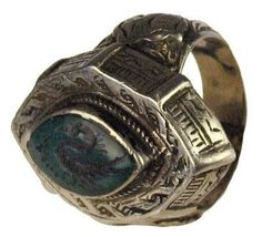 Persian ring : Diamond shaped turquoise with an image of a duck. Original silver setting with inscribed details. 200 B.C.